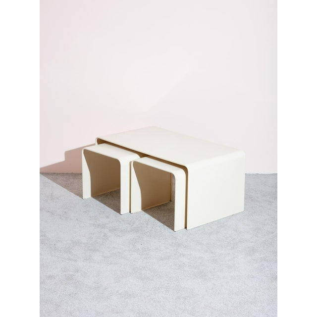 Vintage circa 1980s 3 piece coffee table and side table set. High quality off-white metal tables with rounded over edges...