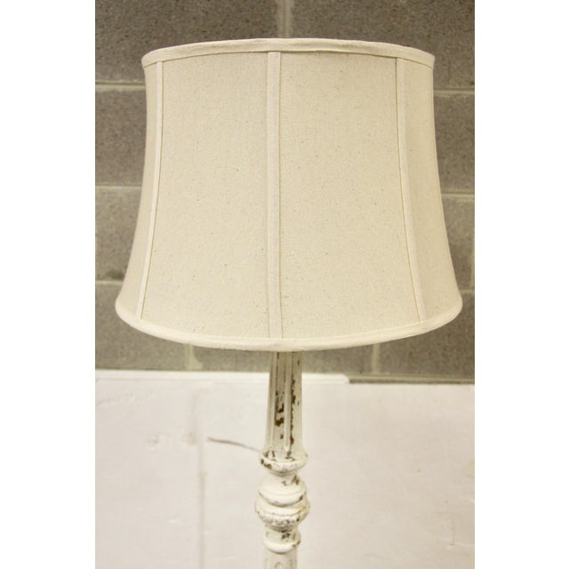 Lovely shabby painted floor lamp. This is a new, contemporary lamp painted and distressed to look older. Features white...