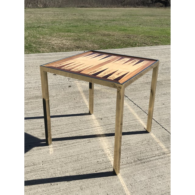 Brass game table tabletop removes and can flip to display either the backgammon board or the checkers or chess table. Burl...