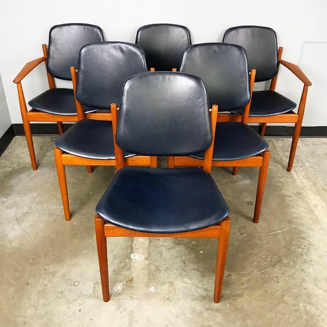 Extraordinary set of six rare teak framed dining chairs designed by Arne Vodder for France & Son. These have just been...