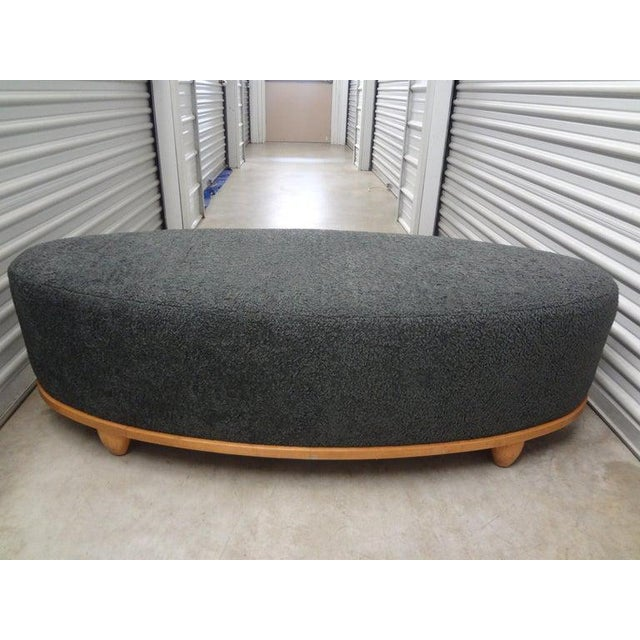 Stunning large mid-century oval bench professionally upholstered in gray shearling. This handsome bench, ottoman or poof...