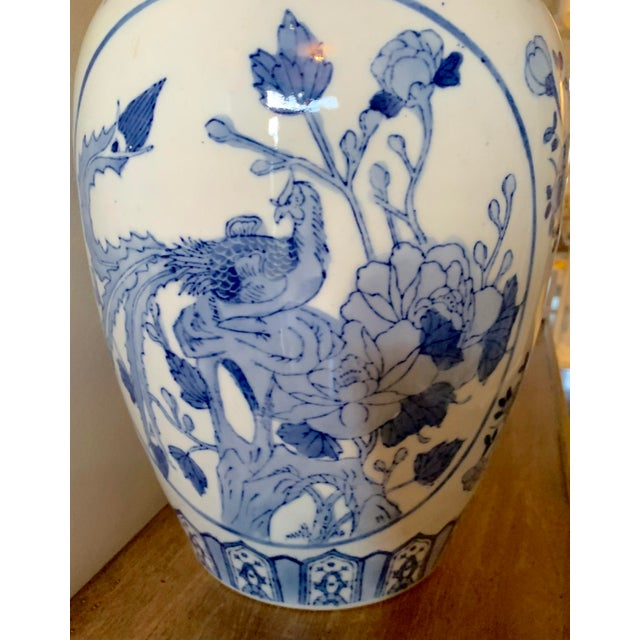 Gorgeous ginger jar with intricate designs in blue tones. Stamped on base.
