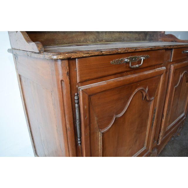 French cherrywood kitchen cupboard/vasselier, c. 1860-1880. Handsomely carved with double drawers above cabinet doors...