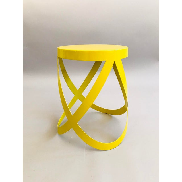 Ribbon Stool by Design Group, Nendo, 2007 for Cappellini. Metal laser-cut plate, lacquered paint in yellow.