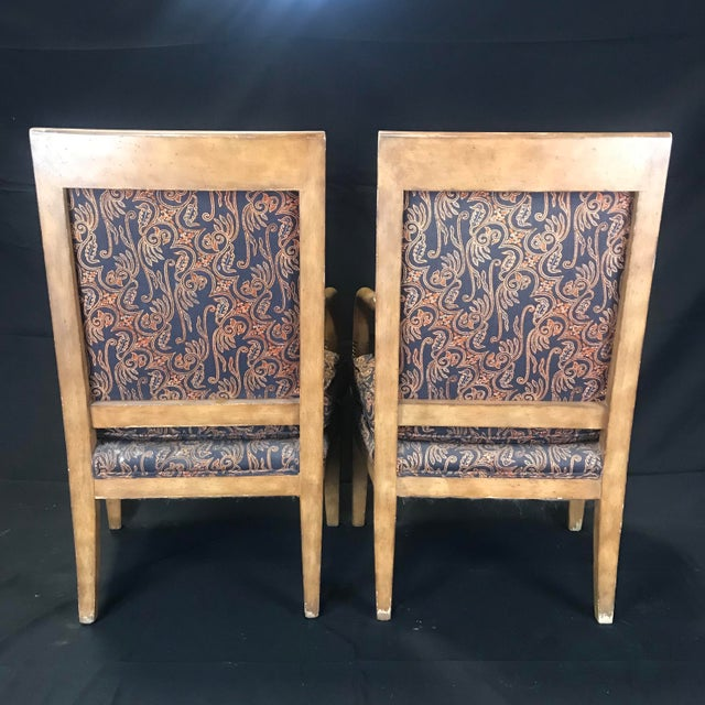 Pair of high quality gorgeous vintage French Empire style club chairs from Bloomingdale's with handsome carved dolphin...