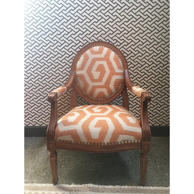 Abbey Lounge Chair upholstered in Jim Thompson Anais Salmon fabric with nailhead detail and deluxe fill seat.