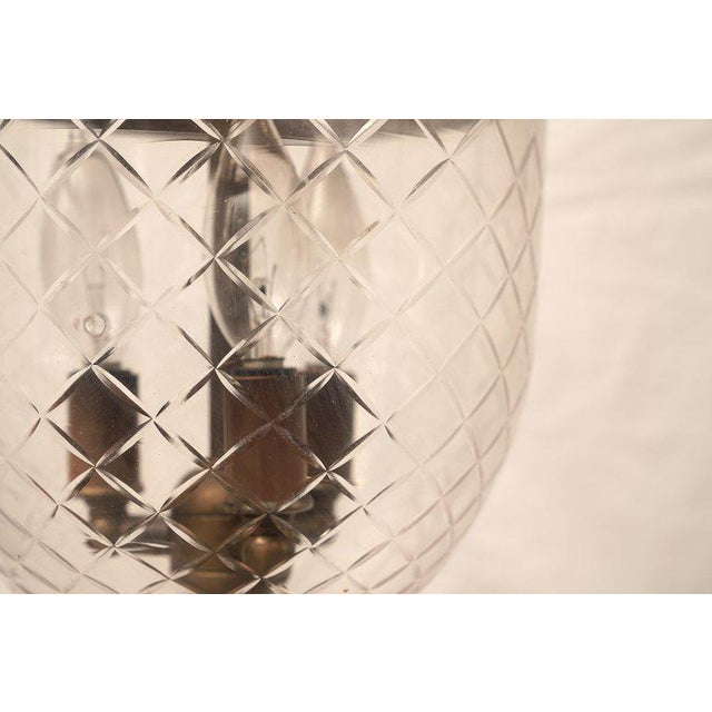 Handblown glass bell jar lantern with a prismatic diamond design etching, complete with the smoke bell lid. Originally...