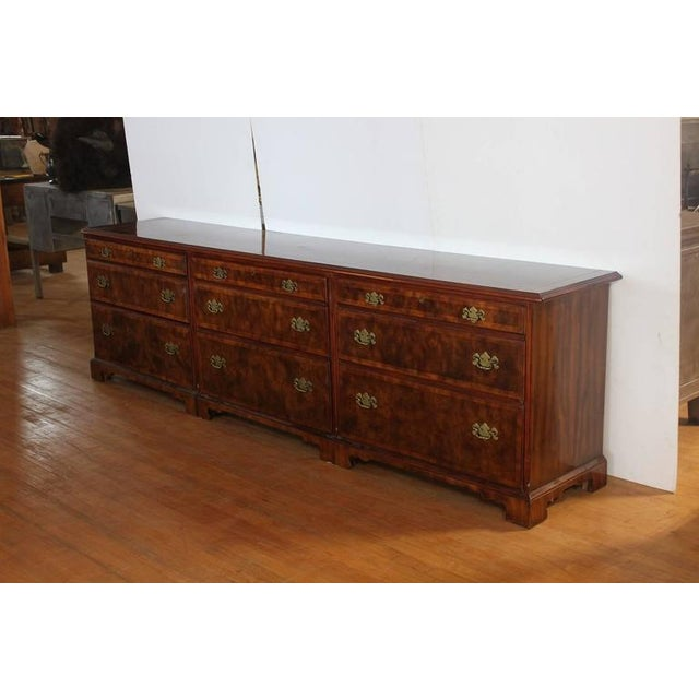 9ft long walnut credenza by Widdicomb with brass hardware. It has brass designer tag.