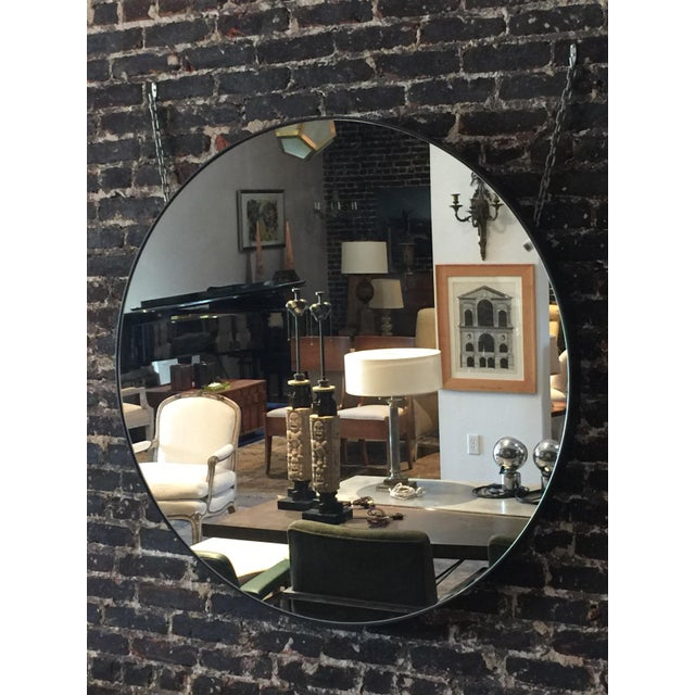 Oversized 'Cerceau' round mirror by Design Frères. Blackened steel frame. Two heavy duty back rings are welded to the...