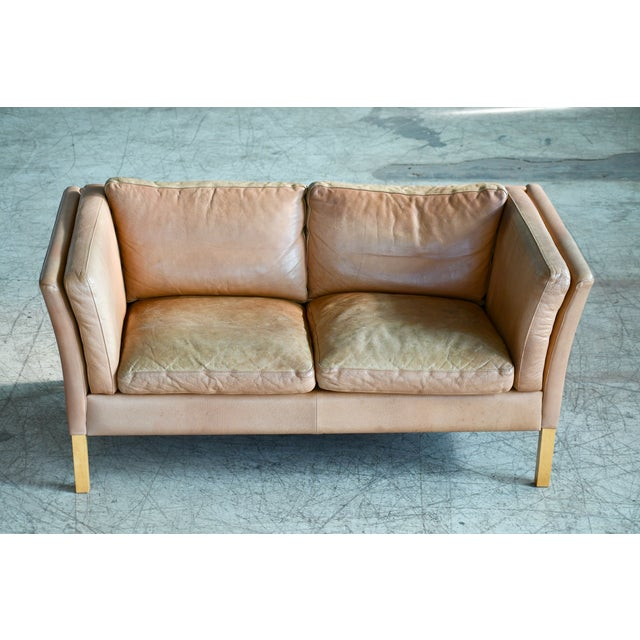 Great loveseat or two-seat sofa made by Stouby Mobler, Denmark. High quality construction in the traditional style of...
