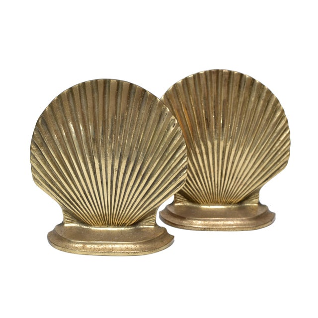 Pair of handcrafted brass scallop shell bookends . Marked underneath, Brass Kingdom North Carolina. Can be polished to...