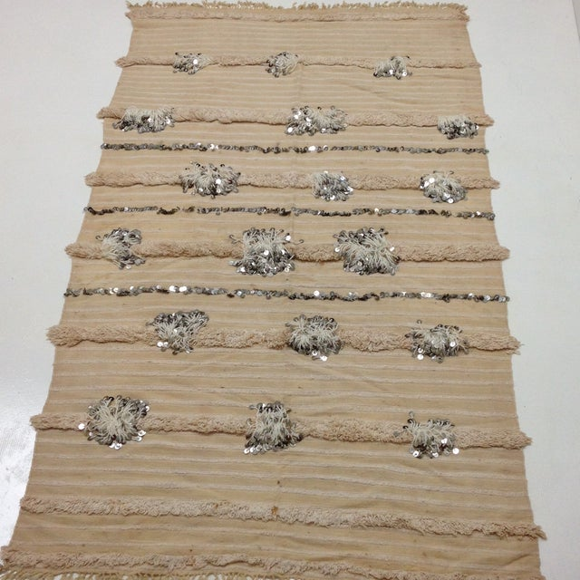 This Handira is one of the oldest, it has a very unique tufting pattern of long threads and sequins. Handiras (also known...