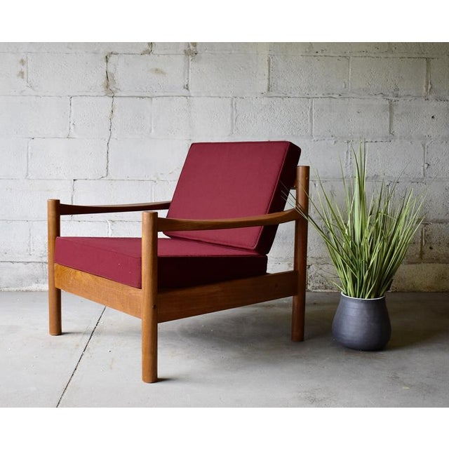 Stunning Mid Century Modern Danish Teak Lounge Chair by Tarm Stole, made in Denmark. The chair features new upholstery in...