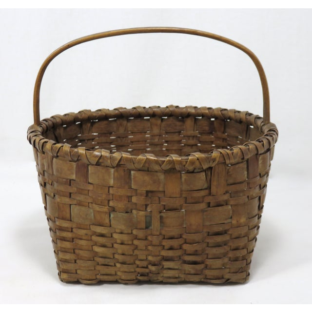 A finely hand woven antique carry basket from the state of Maine. I acquired this piece in the Down East Coastal Maine...