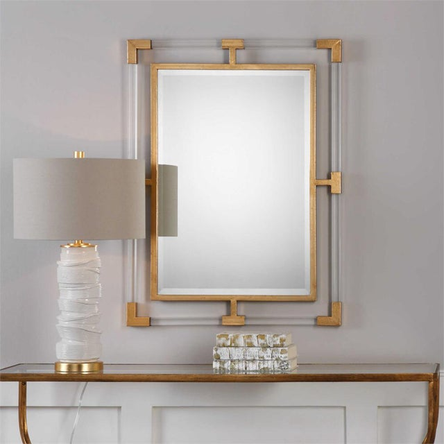 This mirror can certainly serve as a focal point for any room. Combining forged iron, finished in a matte metallic gold ,...