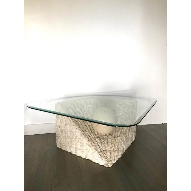 A gorgeous natural Tesselated Mactan stone coffee table in the style of Maitland Smith. Unique modern design and texture....