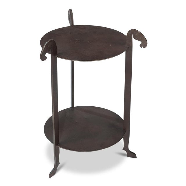 This rustic hand forged side table made by Sarreid is a fabulous accent table/side table with a story! The piece is...