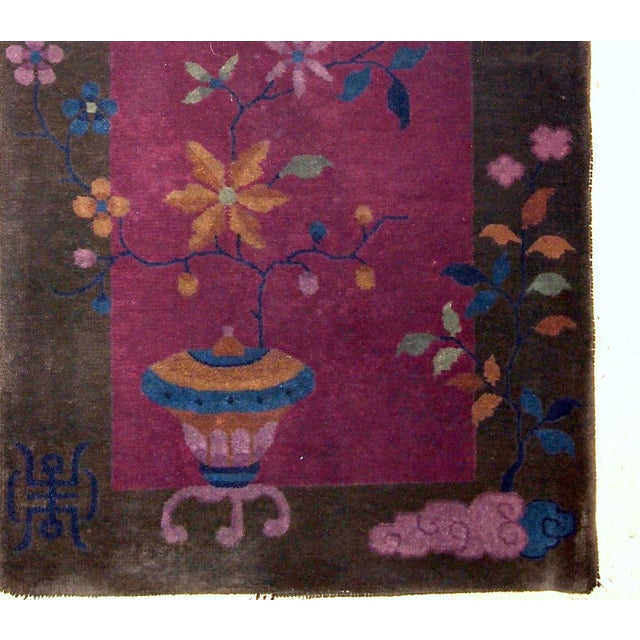 Handmade antique Art Deco Chinese rug in fuchsia and olive shades. The rug is in original good condition from the...