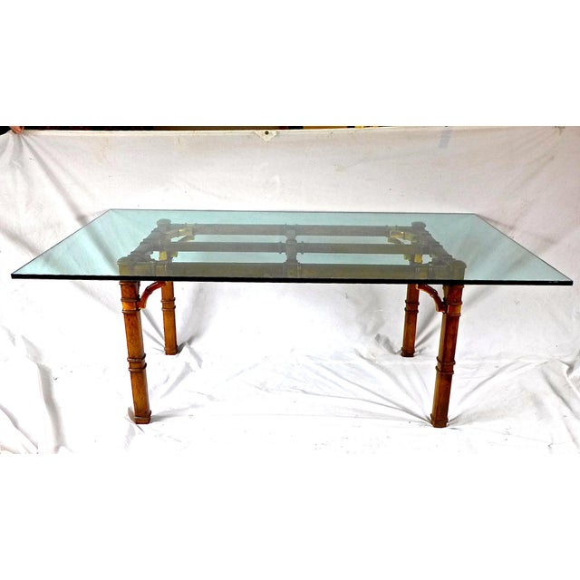 Hollywood Regency faux-bamboo glass-top dining table, seats a comfortable eight people. Brass entwined shoulder buckles to...