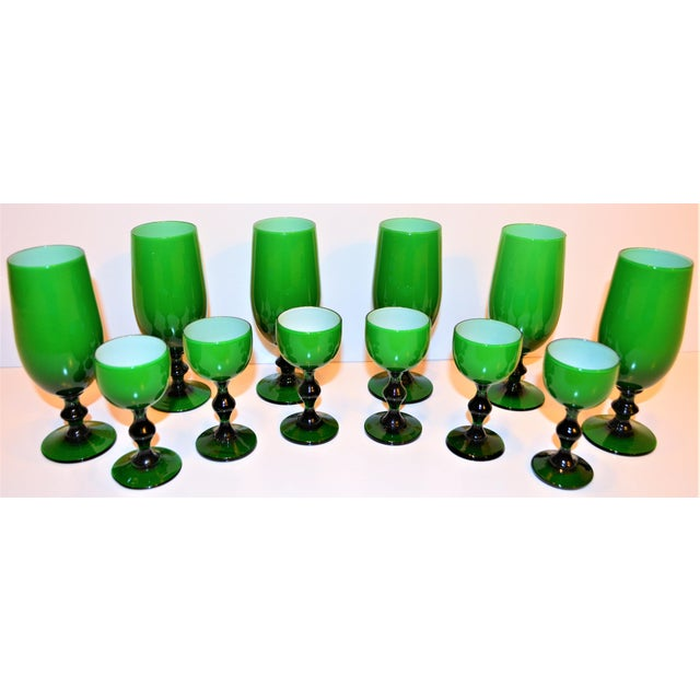This is an amazing set of 12 Carlo Moretti Italian cased stemware. This is a set of 6 wine cordial glasses and 6 liquor...
