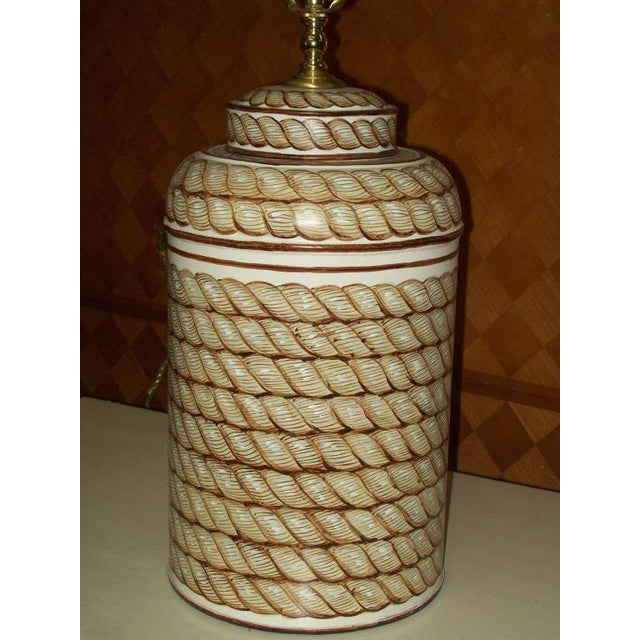 A pair of hand-painted tole canister lamps.