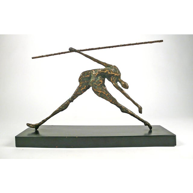 Sculpture by Curtis Jeré constructed of bronze with wood base.