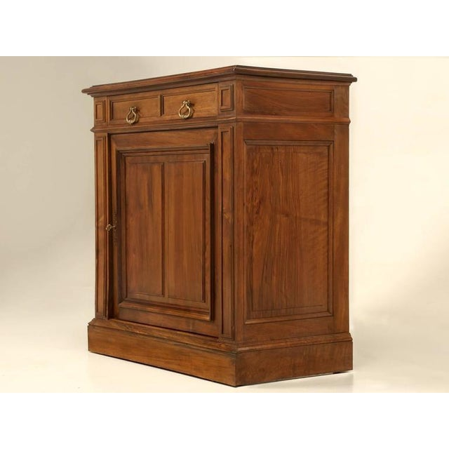 French walnut petite buffet or cupboard that would make for an excellent powder room vanity or just some extra storage in...