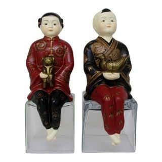 Porcelain Shelf-Sitters, a Pair For Sale