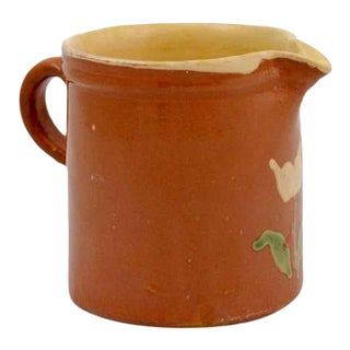 19th Century French Redware Pitcher With White Flower Decor For Sale