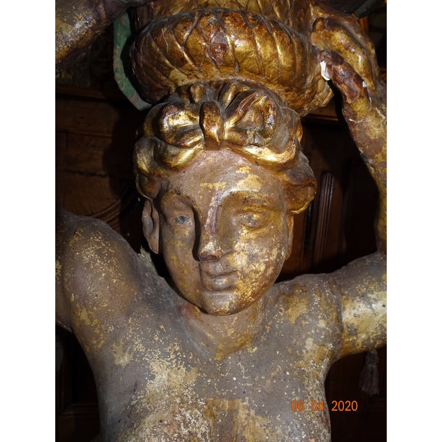 From our las shipment this is a very unique pair of late 17th Century Italian caryatids. (A stone carving of a draped...