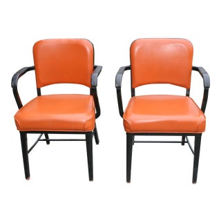 Industrial Arm Chairs in Orange With Black Metal Legs - a Pair For Sale