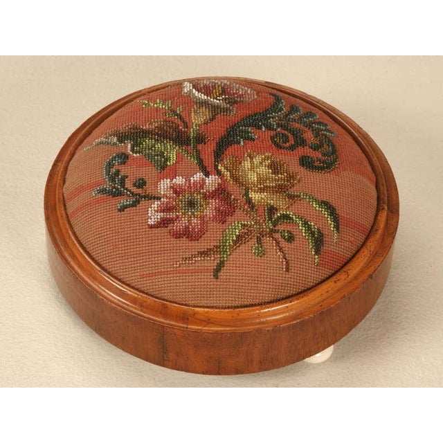 Hand beaded, mahogany framed Victorian ladies tuffet from England. These were utilized to keep feet raised odd cold damp...