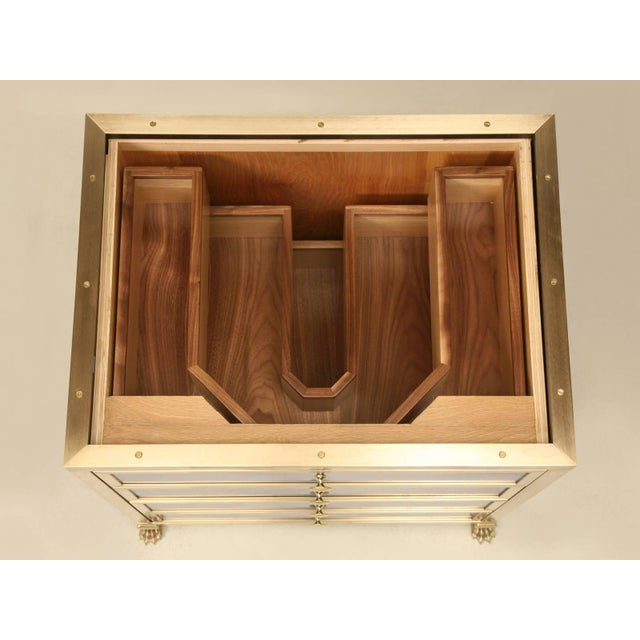 Another design from our Old Plank collection and maybe the ultimate in bathroom vanities, is this solid brass (bronze is...