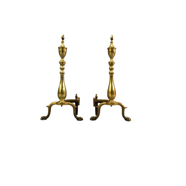 Pair of Chippendale-style brass andirons with paw feet. Marked: Puritan. Tarnished.