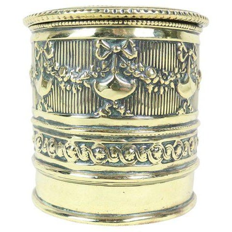 Polished brass string holder with a classical repoussé decoration. Made in England at the beginning of the 20th century....