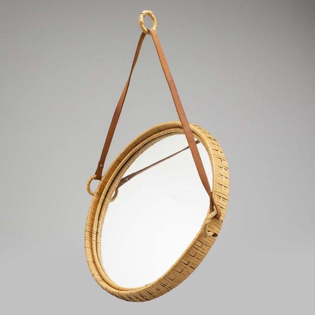 Mirror, rattan, Sweden, 1960s, leather strap.