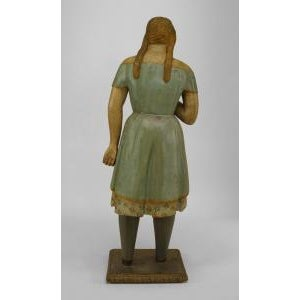 American Country style life size wood figure of young girl with light blue and floral decorated dress (19th Cent.)