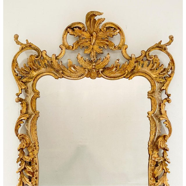 A Vintage Italian gilt and painted mirror, circa 1960.