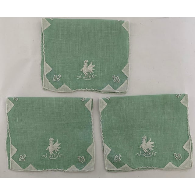 Set of 3 1950s embroidered linen cocktail napkins. Pale green linen with white embroidered rooster motif. Napkins have...