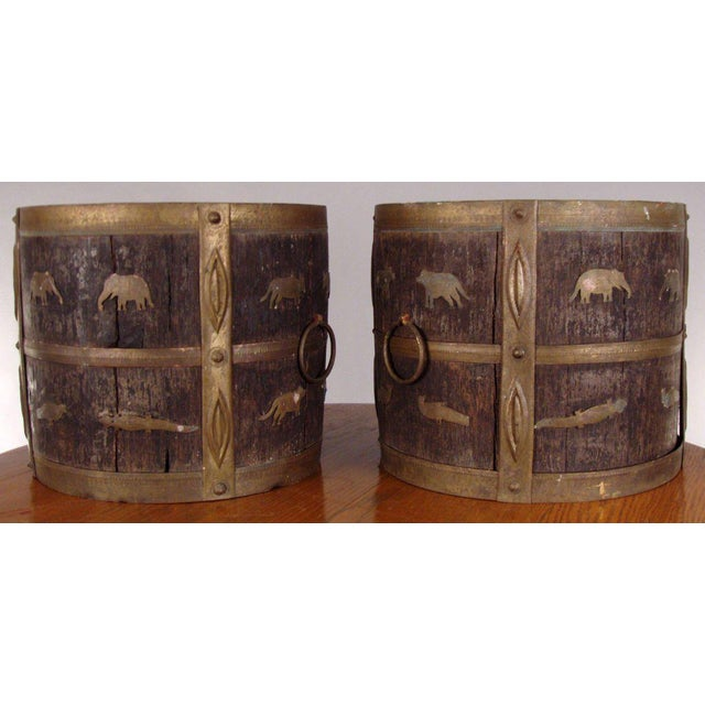 A very unique pair of antique round jardinieres in oak with hand forged brass frame and trim, as well as decorative brass...
