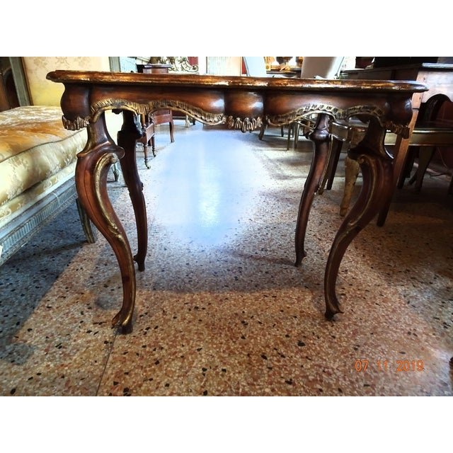 Mid 19th century Portuguese wood coffee table or accent table with curved apron and gilt trim all around. Edges of table...