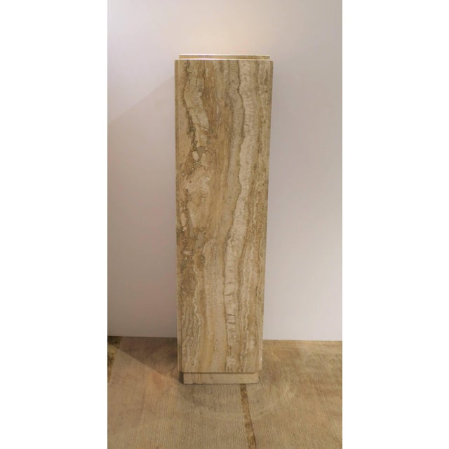 A beautiful Modern Italian travertine marble pedestal column in neutral colors, circa 1970s, Italy. Colors include: white,...