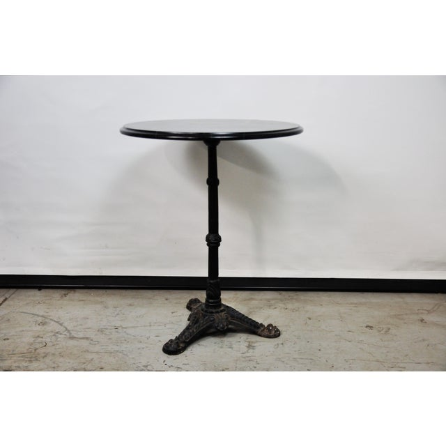 Coax your café over to the dark side! Cast-iron base bistro table has a seriously sexy look to it with its stunning...