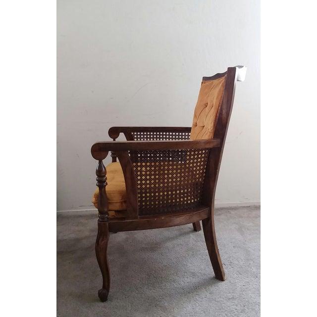 1970's Hollywood Regency Orange Velvet Tufted Cane Wing Chair. This vintage arm chair features plush orange velvet...