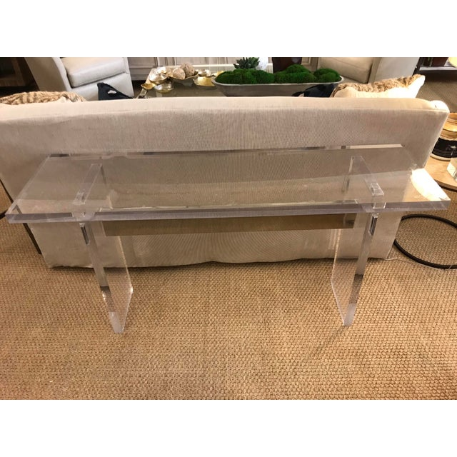 Setting the bar. This acrylic console table is practically invisible! That is, except for the chrome support beam going...