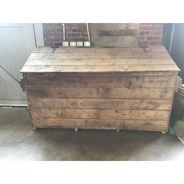 French country large box used for storing firewood.