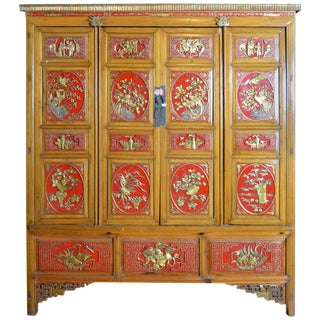 19th Century Chinese Qing Dynasty Wooden Armoire With Hand-Carved Gilt Panels For Sale