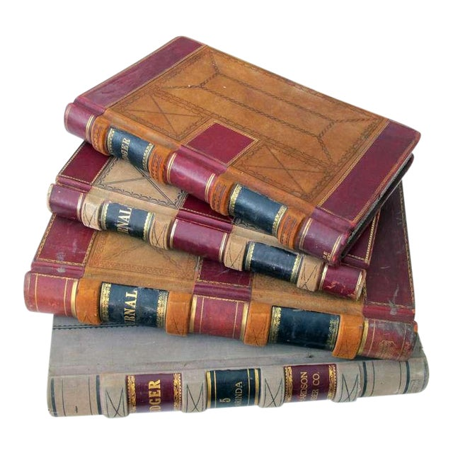 A Large and Unique Set of 4 Leather-Bound Accounting Ledgers with Gilt Highlights For Sale