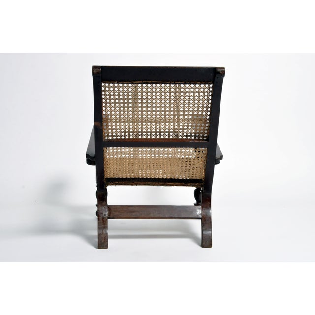 """This Indian """"plantation chair"""" was actually an officer's chair. British military officers reclined on chairs like these..."""