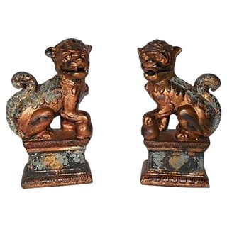 Parcel Gilt Iron Foo Dogs - A Pair